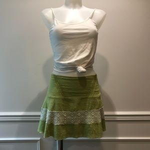 Flirty Miss Money green with white lace mini skirt